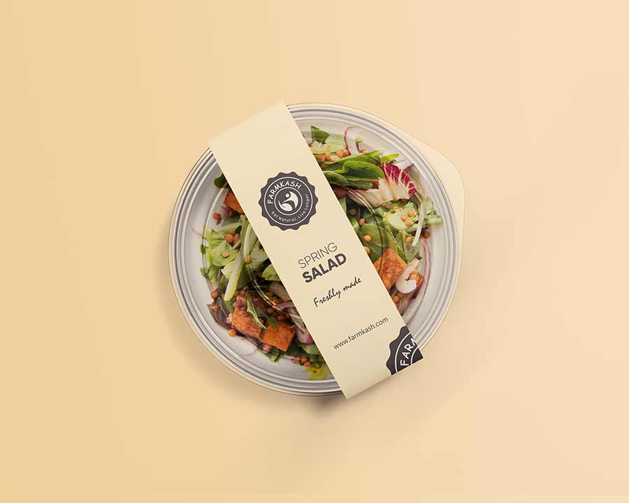 food packaging containing salad with label